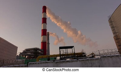 White smoke coming out of an industrial Chimney - White...