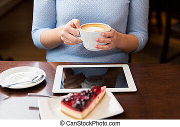 close up of hands with coffee, tablet pc and cake - people,...