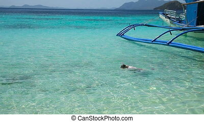 Young girl snorkeling in sea