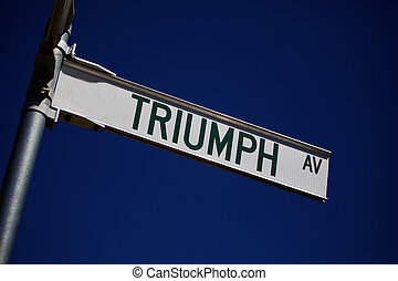 Triumph - A street sign showing the word Triumph