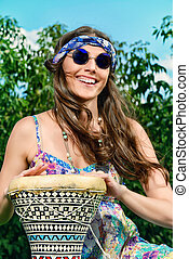 jamaica drum - Happy hippie girl playing her drum outdoor