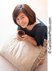 Woman enjoy drinking tea - Young asian woman enjoy drinking...