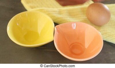 Separating egg yolk from white - Separating egg yolk from...