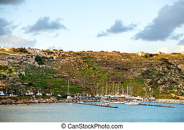 Port of Mgarr at sunset on the small island of Gozo, Malta.