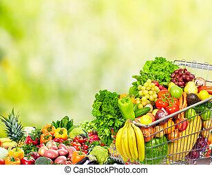 Grocery shopping cart. - Grocery shopping cart with fruits...
