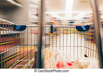 Supermarket cart POV and the blurred background. Close up...