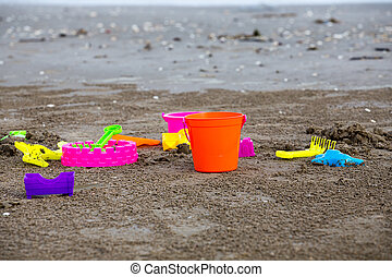 Childrens beach toys - buckets spade and shovel on sand