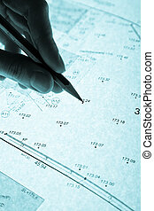 surveyors plan and pencil with backlight - surveyors plan...