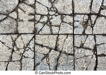 Gray old cracked pavement.
