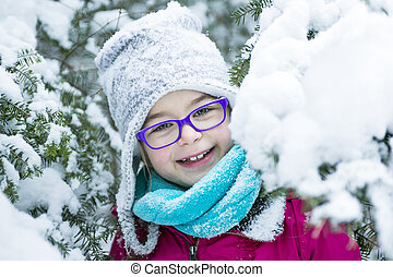 Little Girl Playing with Snow Outdoors in Winter - A Little...