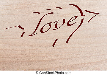 love - two hearts pierced by the arrow of love of maple wood...