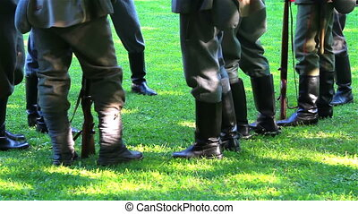 Soldiers feet with military uniform and weapons before...