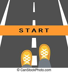 Start line road sign. Man feets standing on road in front of...