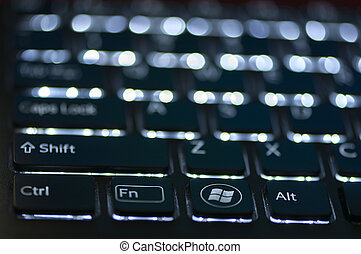 Illuminated keyboard. Focus on Ctrl Fn Alt keys. Shallow...