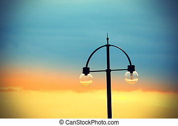 Street light on bright evening sky