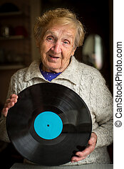 Old grandma with the LP record in hands
