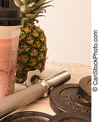 Fitness sports and healthy food - Old used dumbbell with...