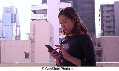 Asian Businesswoman Talking Phone - Happy beautiful Chinese...