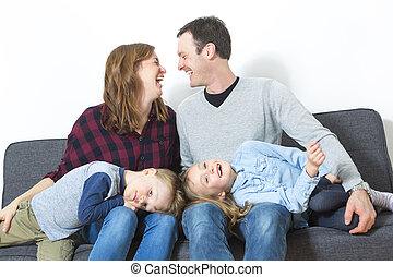 Nice family sit on the livingroom sofa - A Nice family sit...