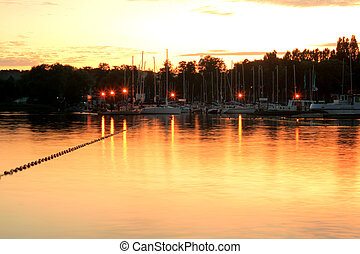 Lake during the evening - Lake and a marina during the...