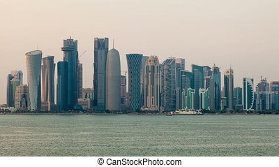 Doha skyline time lapse video from day to night. Qatar,...
