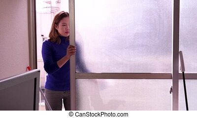 Window Cleaning Young Asian Woman - Asian housemaid cleaning...