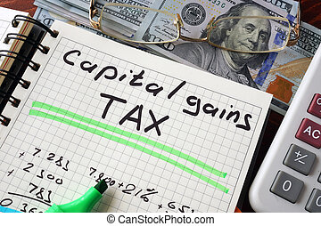 capital gains tax - Notebook with capital gains tax sign on...