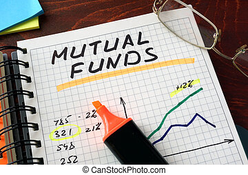 mutual funds - Notebook with mutual funds sign on a table...