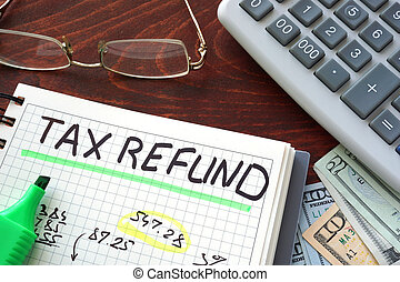 tax refund - Notebook with tax refund sign on a table...