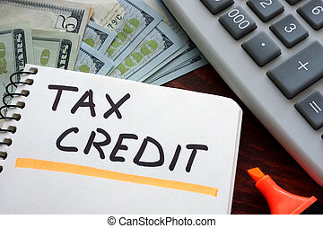 tax credit - Notebook with tax credit sign on a table....