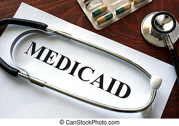 Paper with Medicaid and stethoscope. Medical insurance...