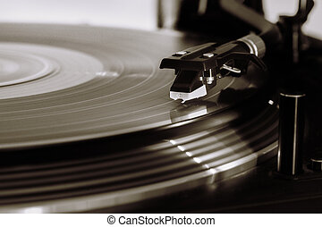 Vinyl - Turntable LP record playing and rotating Vintage...