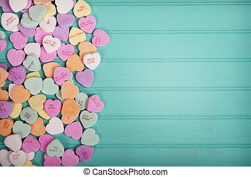 Candy conversation heartson a turquoise blue background -...