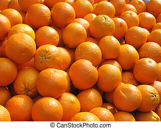 Lots of fresh oranges fruit close up