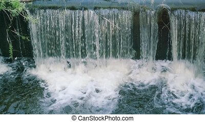 water flows under pressure at hydroelectric dams in slowmotion