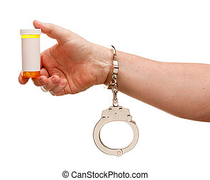 Handcuffed Man Holding Blank Medicine Bottle Isolated on...