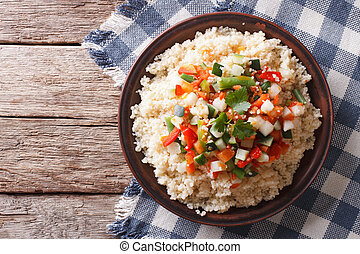 Vegetarian Couscous with vegetables close-up Horizontal top...