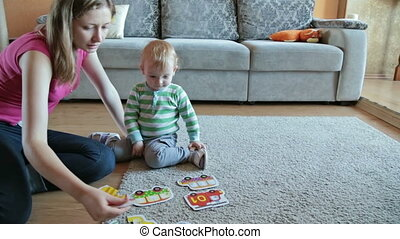 Mother with her son playing with puzzles, HD