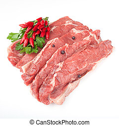 Red Meat - Pieces of raw red meat and hot chili pepper...