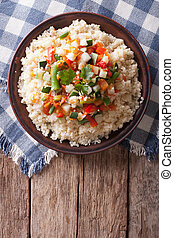 Asian Couscous with vegetables vertical top view - Asian...