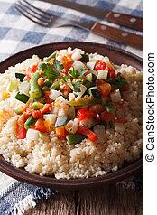 Arabic cuisine: couscous with vegetables close-up Vertical -...