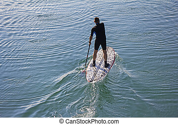 Stand up paddle boarder - Stand up paddle board man...