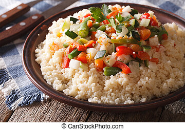 Arabic cuisine: couscous with vegetables close-up horizontal...