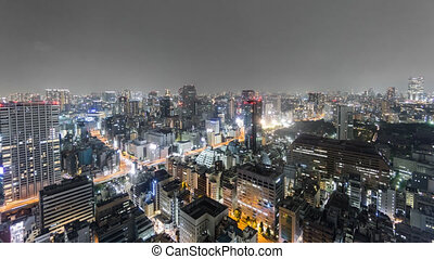 Night Time-Lapse of downtown in Tokyo, aerial view