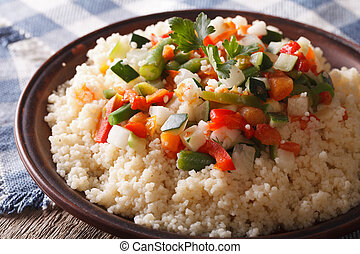 Couscous with seasonal vegetables close-up horizontal -...