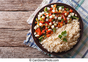 Couscous with vegetables and herbs horizontal top view -...