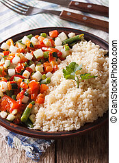 Vegan couscous with vegetable on a plate closeup Vertical -...