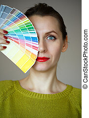 Woman with a red lips looking to a color palette - Woman...