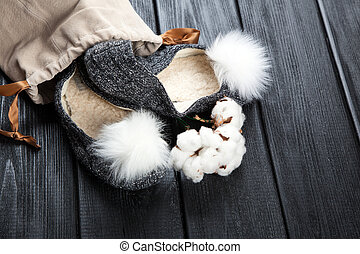 Cozy home slippers - Cozy woolen home slippers on dark wood