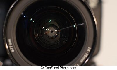 Diaphragm of a camera lens aperture, close up, open - The...